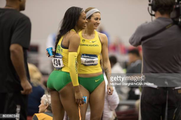 Ariana Washington and Hannah Cunliffe of Oregon embrace following the women's 200 meter dash during the Division I Men's and Women's Indoor Track...