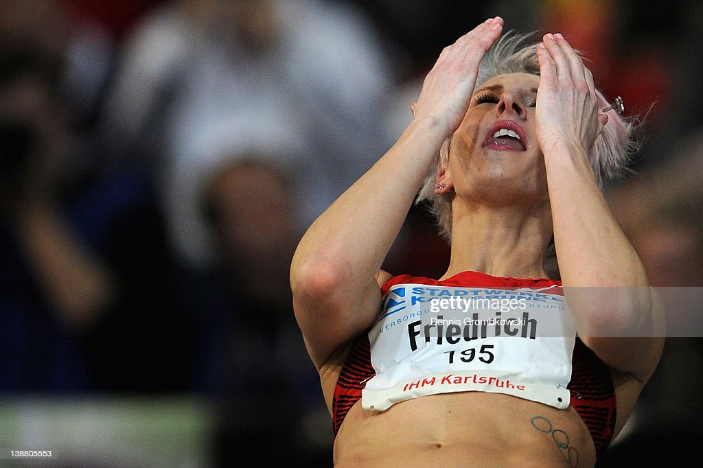 <a gi-track='captionPersonalityLinkClicked' href=/galleries/search?phrase=Ariane+Friedrich&family=editorial&specificpeople=2507867 ng-click='$event.stopPropagation()'>Ariane Friedrich</a> of Germany reacts during Women's High Jump during the International Indoor Track and Field Meeting at Europahalle on February 12, 2012 in Karlsruhe, Germany.