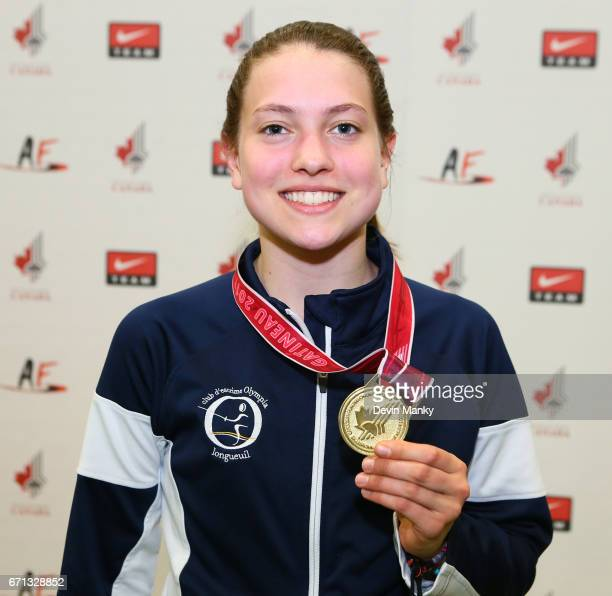 Ariane Leonard poses with her gold medal won during the Cadet Women's Epee event on April 21 2017 at the Canadian National Fencing Championships at...