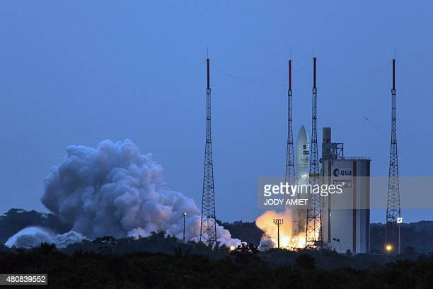 Arianes 5 Launcher lifts off on July 15 2015 from the Kourou Spaceport located in Kourou French Guiana carrying a Brazilian communications satellite...