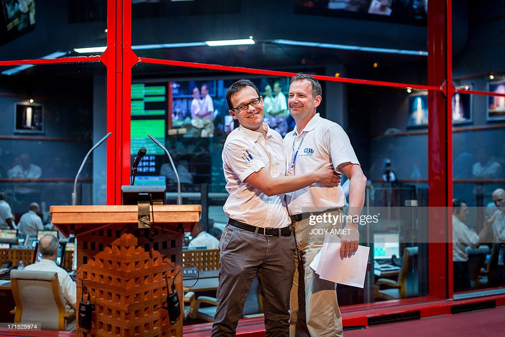 Arianespace Chairman and CEO Stephane Israel (L) and O3B networks CEO Steve Collar react after the launching of Russian Soyouz rocket, carrying four O3b Satellite Constellation, on June 25, 2013 in Kourou space base in the French overseas department of Guiana. AFP PHOTO JODY AMIET