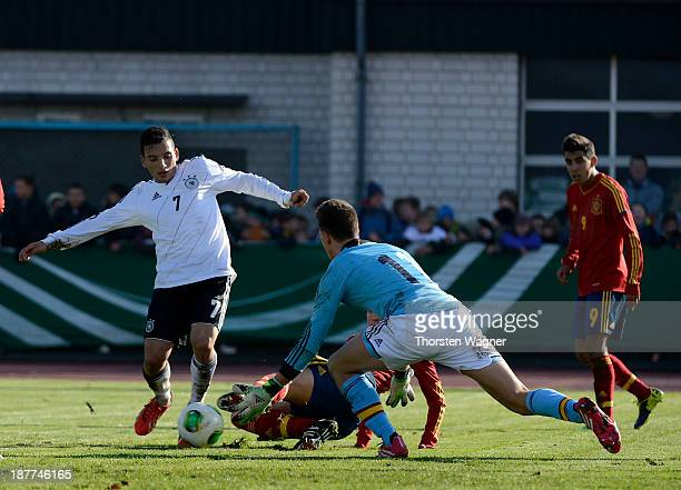 Arianit Ferati of Germany battles for the ball with Carlos Martin Tomas of Spain during the U17 international friendly match between Germany and...