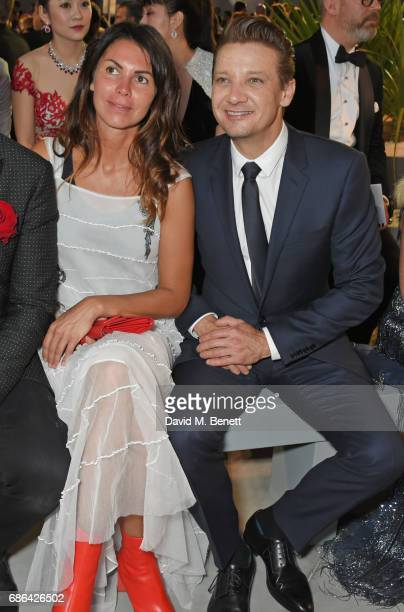 Arianna Alessi and Jeremy Renner attend the Fashion for Relief event during the 70th annual Cannes Film Festival at Aeroport Cannes Mandelieu on May...