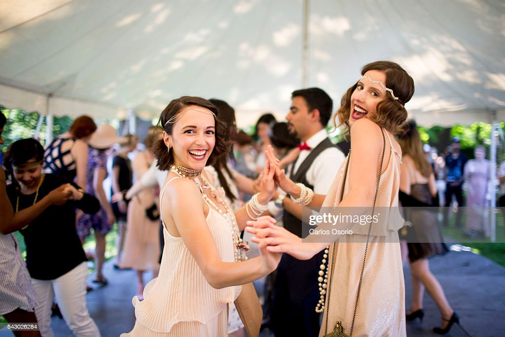 TORONTO, ON - JUNE Arianna Benincasa and Leah Benincasa pose for a photo while dancing. Gatsby Garden Party is a revival event at the Spadina Museum based on Scott Fitzgeralds novel The Great Gatsby with music, food and drinks from the roaring 1920s. Over the soft, sweet tones of cool jazz, guests participate in a costume contest, or play a game of croquet.June 25, 2016.