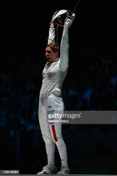 Arianna Errigo of Italy celebrates winning her semi final match against Valentina Vezzali of Italy in the Women's Foil Individual Fencing on day one...