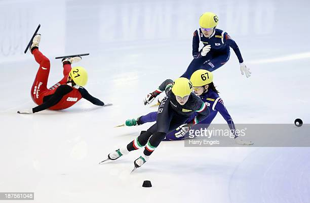 Arianna Fontana of Italy leads as Meng Wang of China and Suk Hee Shim of Korea crash during the women's 1000m semifinal on day four of the Samsung...