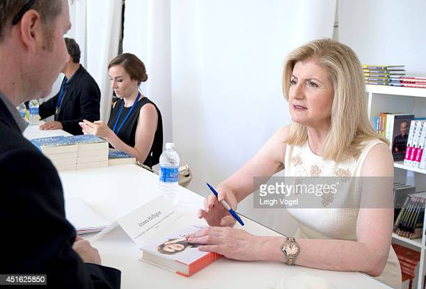 Arianna Huffington signs a copy of her book 'Thrive' during the Aspen Ideas Festival 2014 at the Aspen Institute on July 2 2014 in Aspen Colorado