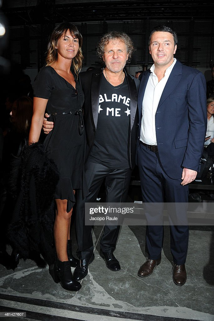 Arianna Lessi, Renzo Rosso and Matteo Renzi attend Diesel Black Gold fashion show during Pitti Immagine Uomo 85 on January 8, 2014 in Florence, Italy.
