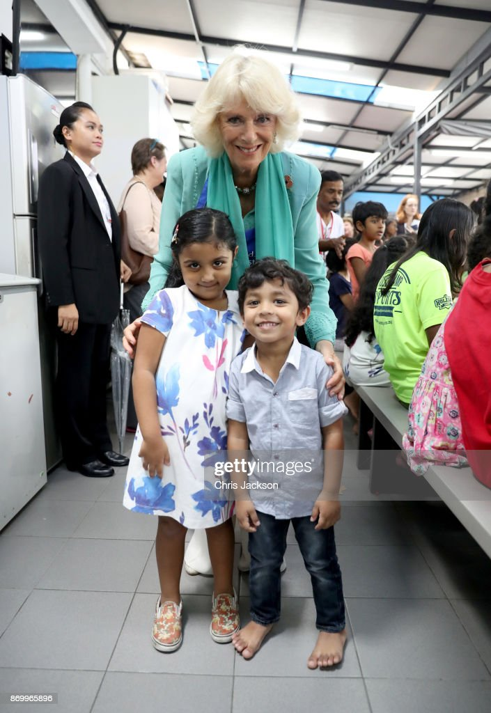 Arianna Lewis (L) presented Camilla, Duchess of Cornwall a bracelet at The Lost Food Project and Lighthouse Children's Welfare Centre during her visit on November 4, 2017 in Kuala Lumpur, Malaysia. The Lost Food Project collects surplus food from supermarkets and manufacturers in Malaysia and distributes it to those who really need it. The Lighthouse Children's Welfare Home houses 60 disadvantaged children, aged one to 18 years old. Prince Charles, Prince of Wales and Camilla, Duchess of Cornwall are on a tour of Singapore, Malaysia, Brunei and India.