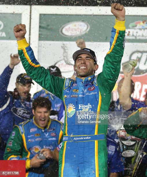 Aric Almirola celebrates in Victory Lane after winning the Subway Firecracker 250 at Daytona International Speedway in Daytona Beach Fla on Friday...