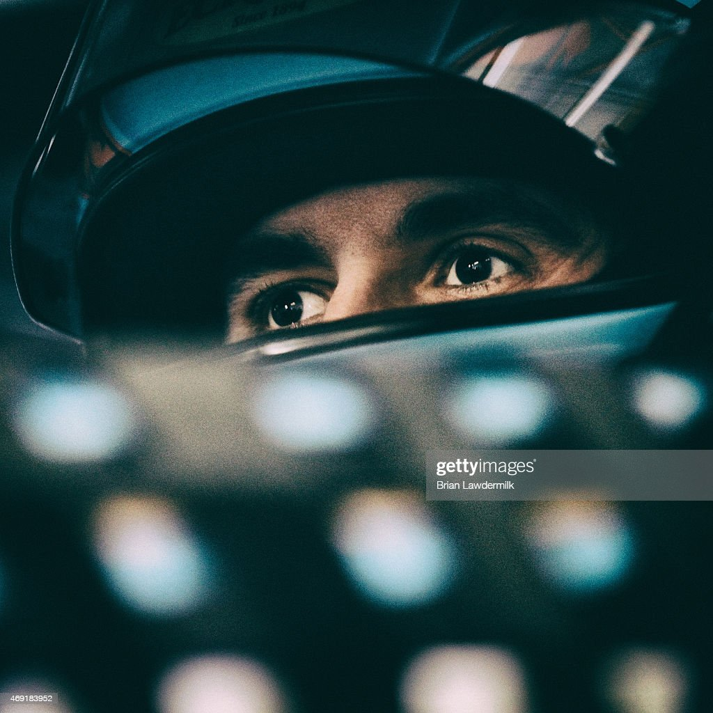 Aric Almirola, driver of the #43 Eckrich Ford, looks on in the garage area during practice for the NASCAR Sprint Cup Series Duck Commander 500 at Texas Motor Speedway on April 10, 2015 in Fort Worth, Texas.