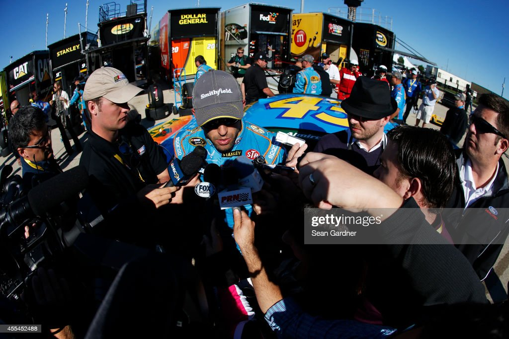 <a gi-track='captionPersonalityLinkClicked' href=/galleries/search?phrase=Aric+Almirola&family=editorial&specificpeople=574878 ng-click='$event.stopPropagation()'>Aric Almirola</a>, driver of the #43 Eckrich Ford, speaks to the media after an on track incident during the NASCAR Sprint Cup Series MyAFibStory.com 400 at Chicagoland Speedway on September 14, 2014 in Joliet, Illinois.