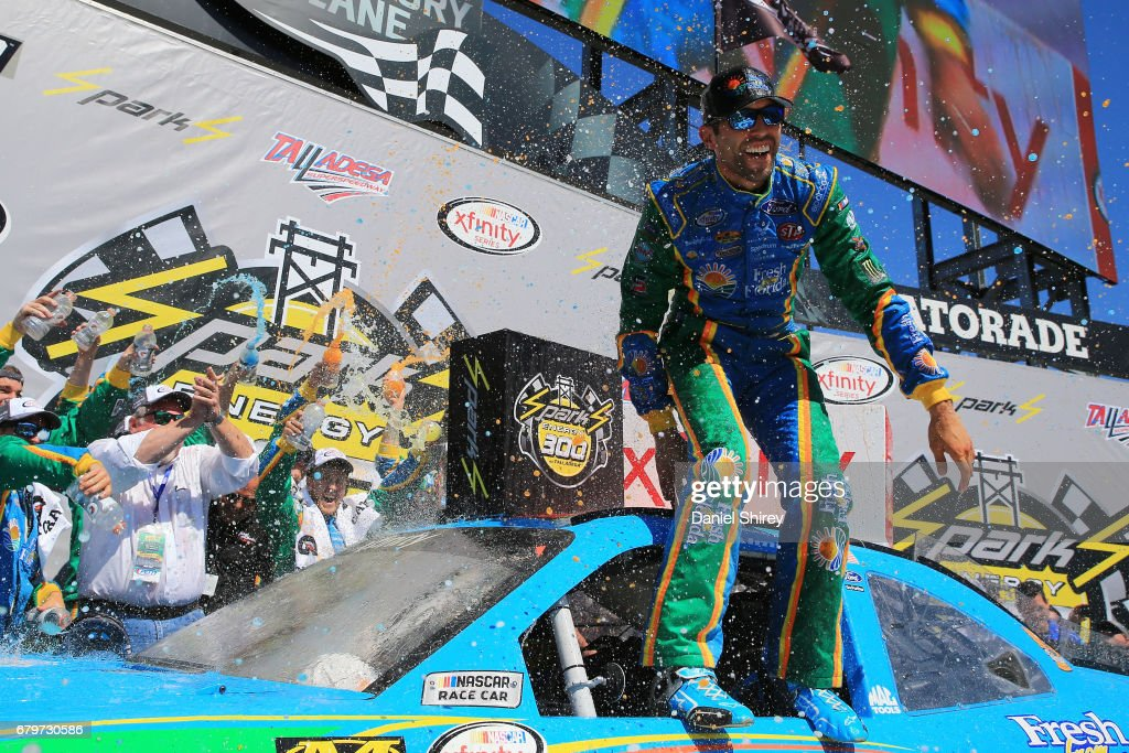 Aric Almirola, driver of the #98 Fresh from Florida Ford, celebrates in Victory Lane after winning the NASCAR XFINITY Series Sparks Energy 300 at Talladega Superspeedway on May 6, 2017 in Talladega, Alabama.