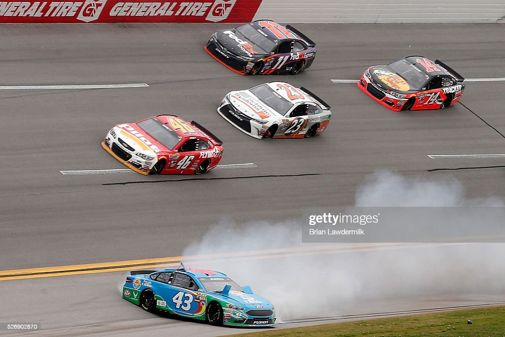 <a gi-track='captionPersonalityLinkClicked' href=/galleries/search?phrase=Aric+Almirola&family=editorial&specificpeople=574878 ng-click='$event.stopPropagation()'>Aric Almirola</a>, driver of the #43 Fresh From Florida Ford, has an on track incident during the NASCAR Sprint Cup Series GEICO 500 at Talladega Superspeedway on May 1, 2016 in Talladega, Alabama.