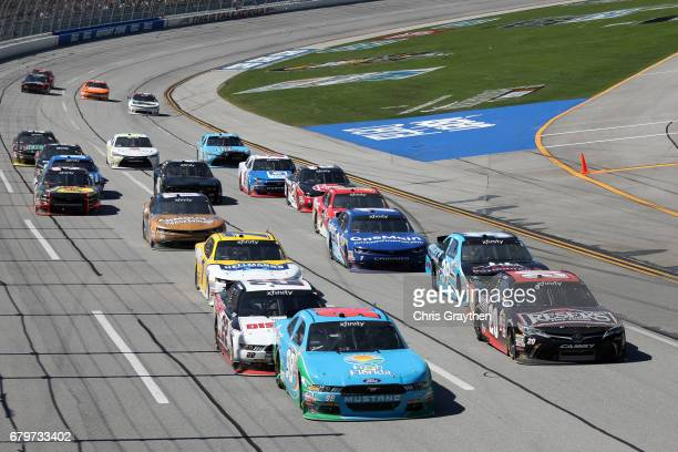 Aric Almirola driver of the Fresh from Florida Ford leads the field during the NASCAR XFINITY Series Sparks Energy 300 at Talladega Superspeedway on...