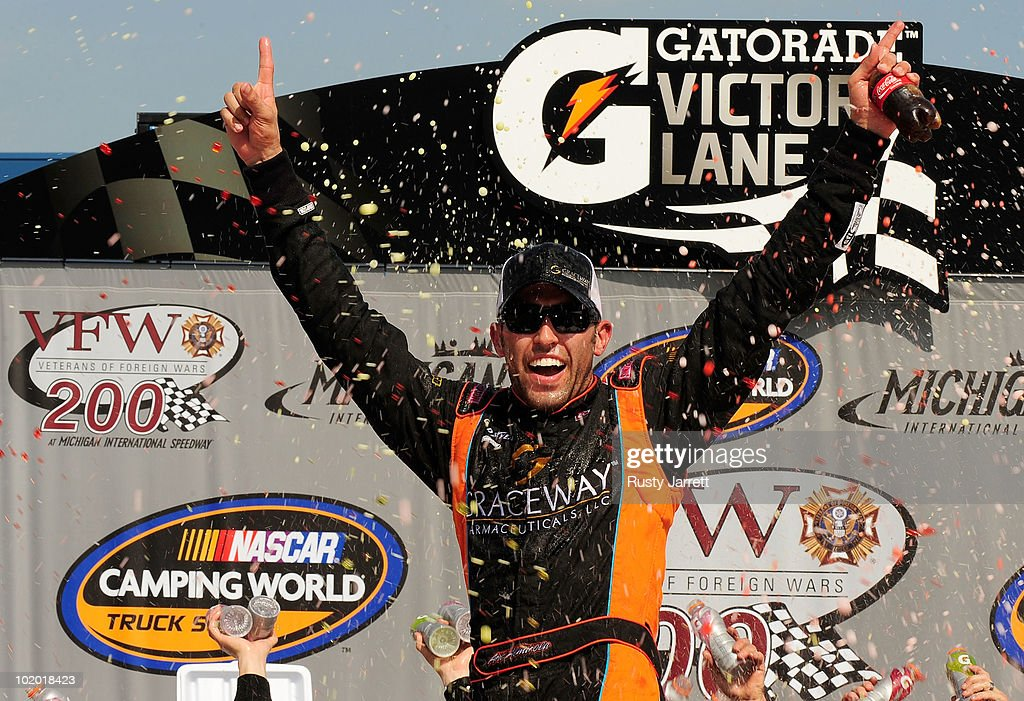 Aric Almirola, driver of the #51 Graceway Pharmaceuticals Toyota, celebrates in Victory Lane after winning the NASCAR Camping World Truck Series VFW 200 at Michigan International Speedway on June 12, 2010 in Brooklyn, Michigan.