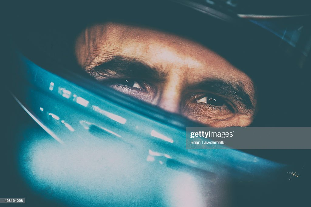 Aric Almirola, driver of the #43 Smithfield Foods Ford, sits in his car during practice for the NASCAR Sprint Cup Series Ford EcoBoost 400 at Homestead-Miami Speedway on November 21, 2015 in Homestead, Florida.