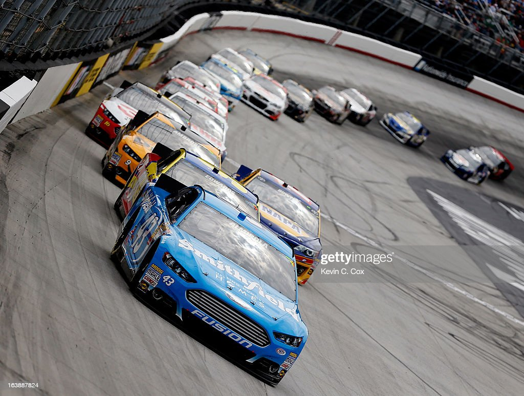 Aric Almirola, driver of the #43 Smithfield Ford, leads a group of cars during the NASCAR Sprint Cup Series Food City 500 at Bristol Motor Speedway on March 17, 2013 in Bristol, Tennessee.