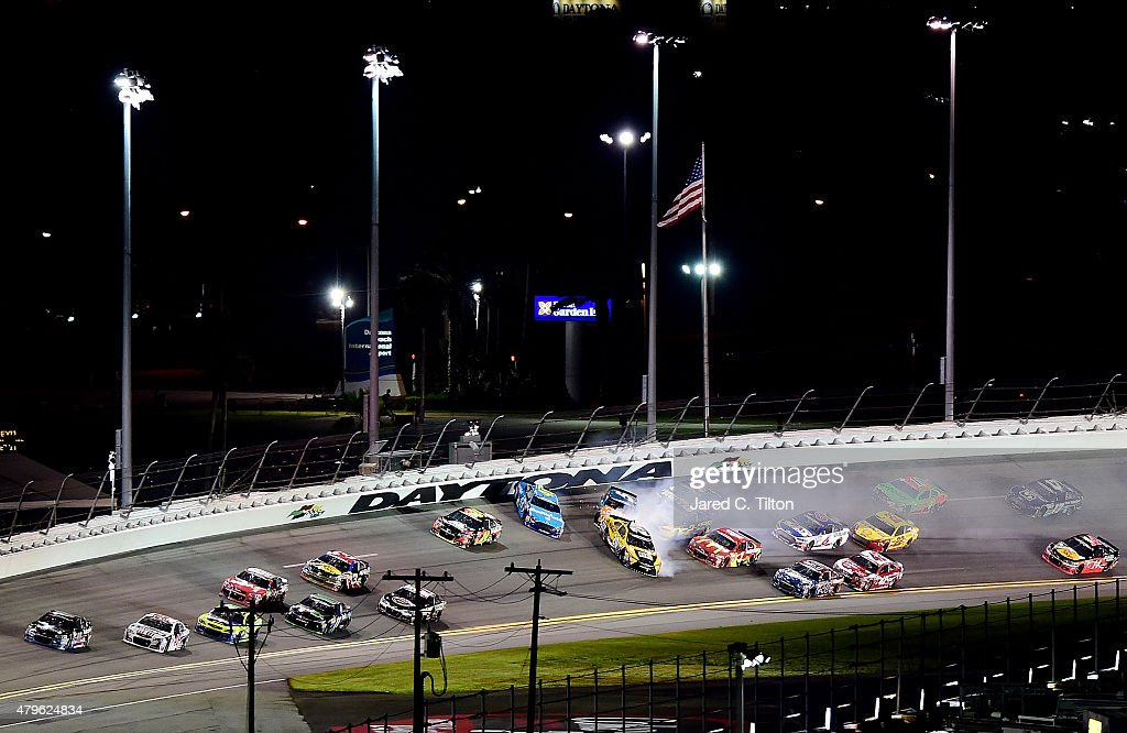 <a gi-track='captionPersonalityLinkClicked' href=/galleries/search?phrase=Aric+Almirola&family=editorial&specificpeople=574878 ng-click='$event.stopPropagation()'>Aric Almirola</a>, driver of the #43 Smithfield Ford, <a gi-track='captionPersonalityLinkClicked' href=/galleries/search?phrase=Matt+Kenseth&family=editorial&specificpeople=204192 ng-click='$event.stopPropagation()'>Matt Kenseth</a>, driver of the #20 DeWalt Made in USA Toyota, and <a gi-track='captionPersonalityLinkClicked' href=/galleries/search?phrase=Kasey+Kahne&family=editorial&specificpeople=183374 ng-click='$event.stopPropagation()'>Kasey Kahne</a>, driver of the #5 Great Clips/Shark Week Chevrolet, are involved in an incident during the NASCAR Sprint Cup Series Coke Zero 400 Powered by Coca-Cola at Daytona International Speedway on July 6, 2015 in Daytona Beach, Florida.