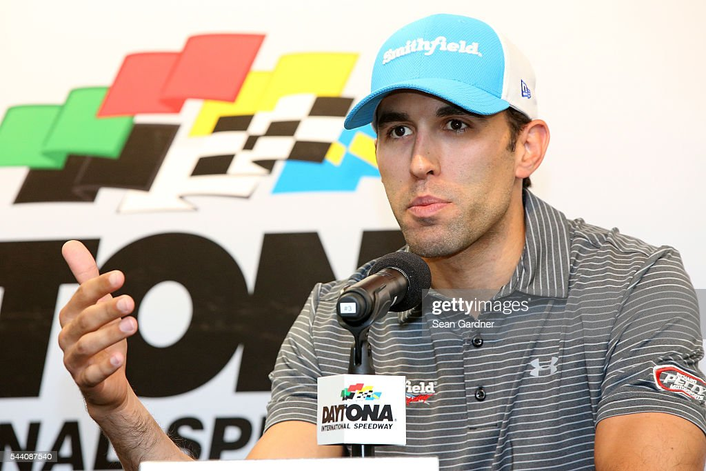 Aric Almirola, driver of the #43 Smithfield Ford, speaks to the media during a press conference prior to qualifying for the NASCAR Sprint Cup Series Coke Zero 400 at Daytona International Speedway on July 1, 2016 in Daytona Beach, Florida.