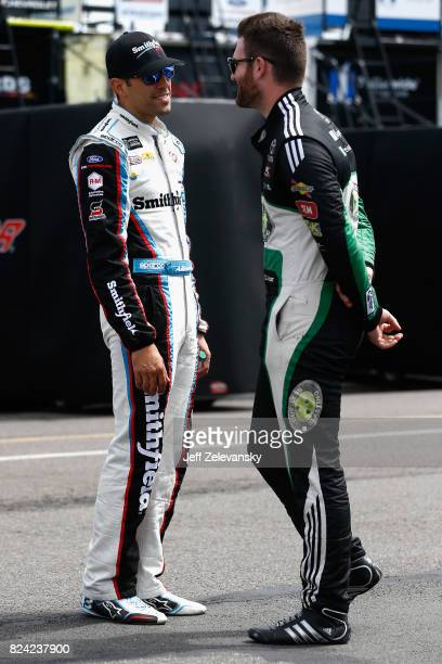 Aric Almirola driver of the Smithfield Ford speaks with Corey LaJoie driver of the Lehigh Valley Phantoms Toyota in the garage area during practice...