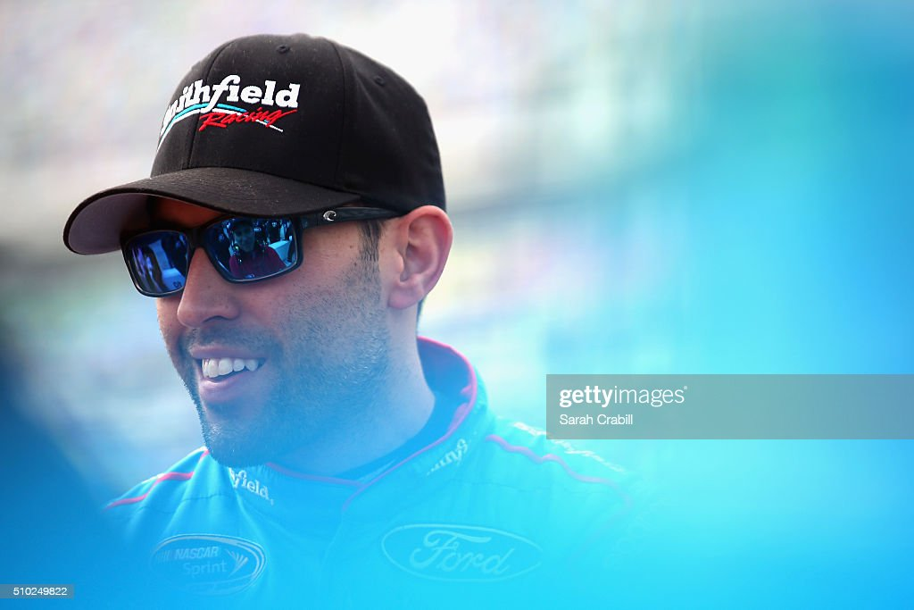 Aric Almirola, driver of the #43 Smithfield Ford, stands on the grid during qualifying for the NASCAR Sprint Cup Series Daytona 500 at Daytona International Speedway on February 14, 2016 in Daytona Beach, Florida.