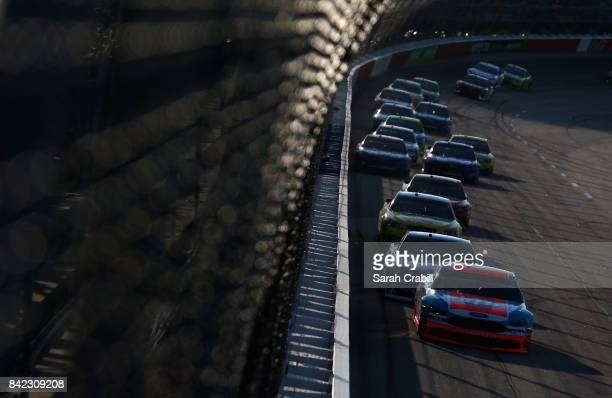 Aric Almirola driver of the STP Ford leads a pack of cars during the Monster Energy NASCAR Cup Series Bojangles' Southern 500 at Darlington Raceway...