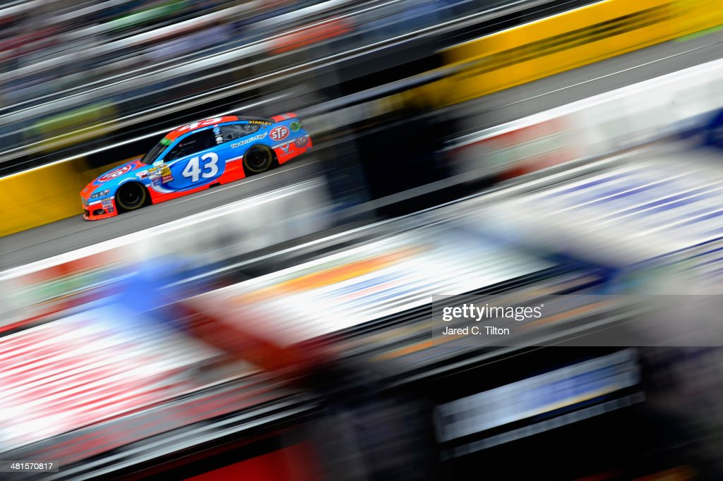 Aric Almirola, driver of the #43 STP Ford, races during the NASCAR Sprint Cup Series STP 500 at Martinsville Speedway on March 30, 2014 in Martinsville, Virginia.