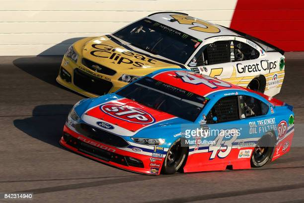 Aric Almirola driver of the STP Ford races Kasey Kahne driver of the Great Clips Throwback Chevrolet during the Monster Energy NASCAR Cup Series...
