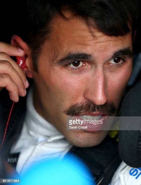 Aric Almirola driver of the STP Ford sits in his car during practice for the Monster Energy NASCAR Cup Series Bojangles' Southern 500 at Darlington...