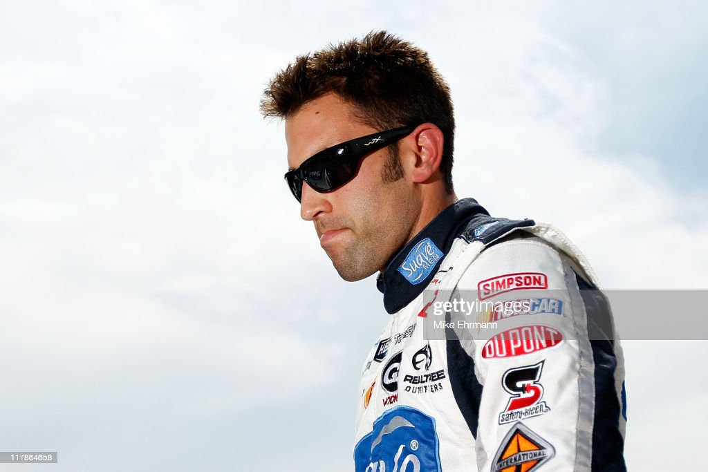<a gi-track='captionPersonalityLinkClicked' href=/galleries/search?phrase=Aric+Almirola&family=editorial&specificpeople=574878 ng-click='$event.stopPropagation()'>Aric Almirola</a>, driver of the #88 Suave Men Chevrolet, looks on during qualifying for the NASCAR Nationwide Series Subway Jalapeno 250 Powered by Coca-Cola at Daytona International Speedway on July 1, 2011 in Daytona Beach, Florida.