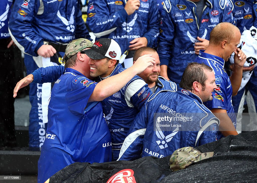 Aric Almirola, driver of the #43 United States Air Force Ford, celebrates in Victory Lane after winning the NASCAR Sprint Cup Series Coke Zero 400 after the race was called for weather at Daytona International Speedway on July 6, 2014 in Daytona Beach, Florida.