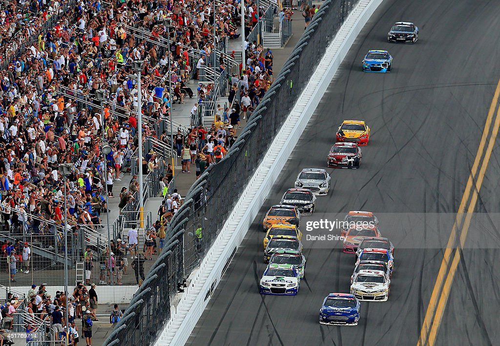 Aric Almirola, driver of the #43 United States Air Force Ford, leads a pack of cars during the NASCAR Sprint Cup Series Coke Zero 400 at Daytona International Speedway on July 6, 2014 in Daytona Beach, Florida.