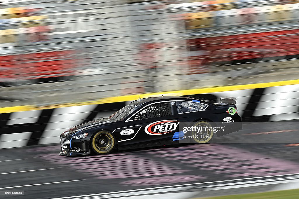 Aric Almirola drives the Richard Petty Motorsports Ford during testing at Charlotte Motor Speedway on December 11, 2012 in Concord, North Carolina.