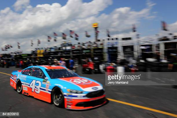 Aric Almirola drives the STP Ford through the garage area during practice for the Monster Energy NASCAR Cup Series Bojangles' Southern 500 at...