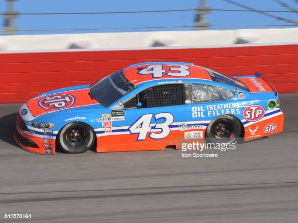 Aric Almirola Richard Petty Motorsports STP Ford Fusion races through the turns during the NASCAR Monster Energy Cup Series Bojangles Southern 500 on...