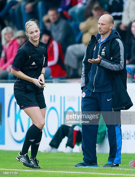 Arie van Lent head coach of Offenbach speaks with referee Bibiana Steinhaus during the Third League match between SpVgg Unterhaching and Kickers...
