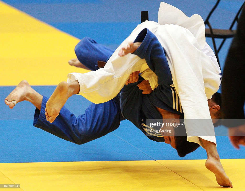 Ariel Alencar of Brazil (Blue) and Ming-Yen Tsai of Chinese Taipei during the gold medal match of the M-60 kg division of the Judo event in the Sports Halls during day four of the Australian Youth Olympic Festival at Sydney Olympic Park Sports Centre on January 19, 2013 in Sydney, Australia.