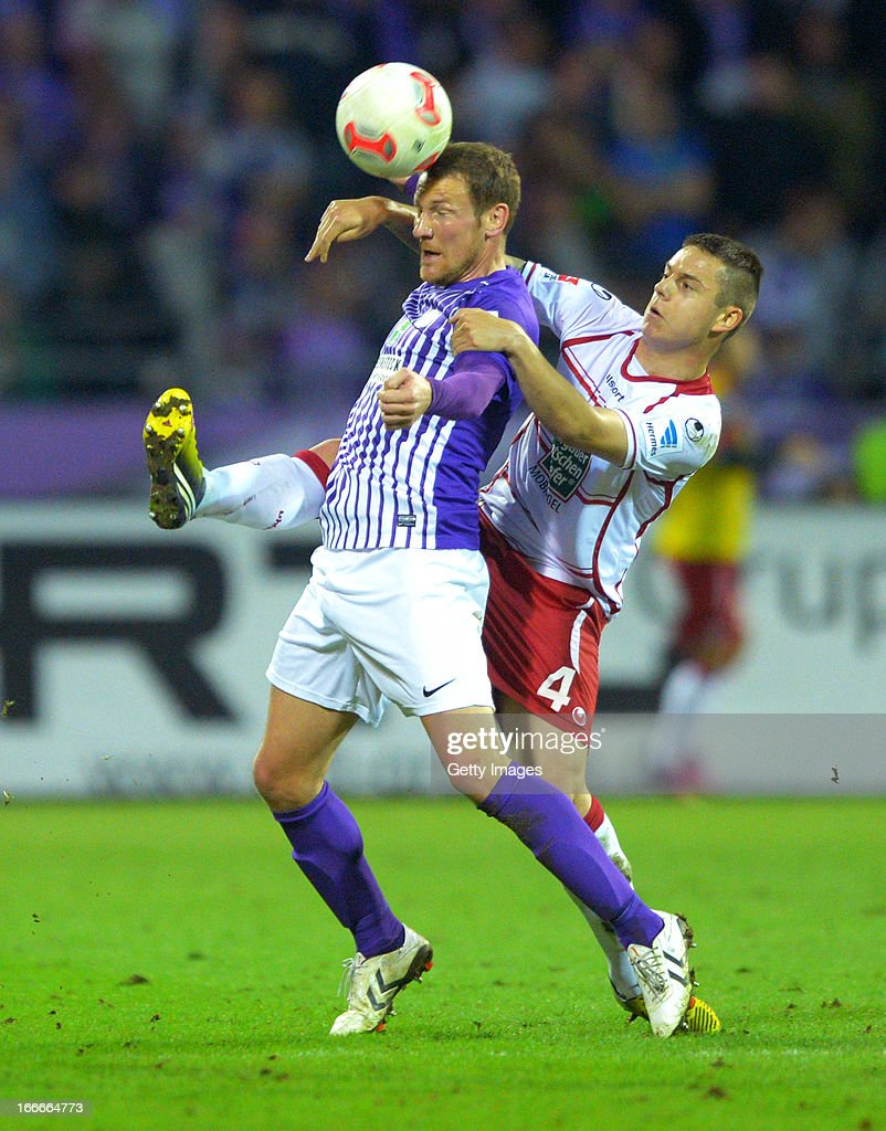 Ariel Borysiuk of Kaiserslautern challenges Michael Fink of Aue during the Second Bundesliga match between Erzgebirge Aue and 1. FC Kaiserslautern at Erzgebirgs Stadium on April 15, 2013 in Aue, Germany.
