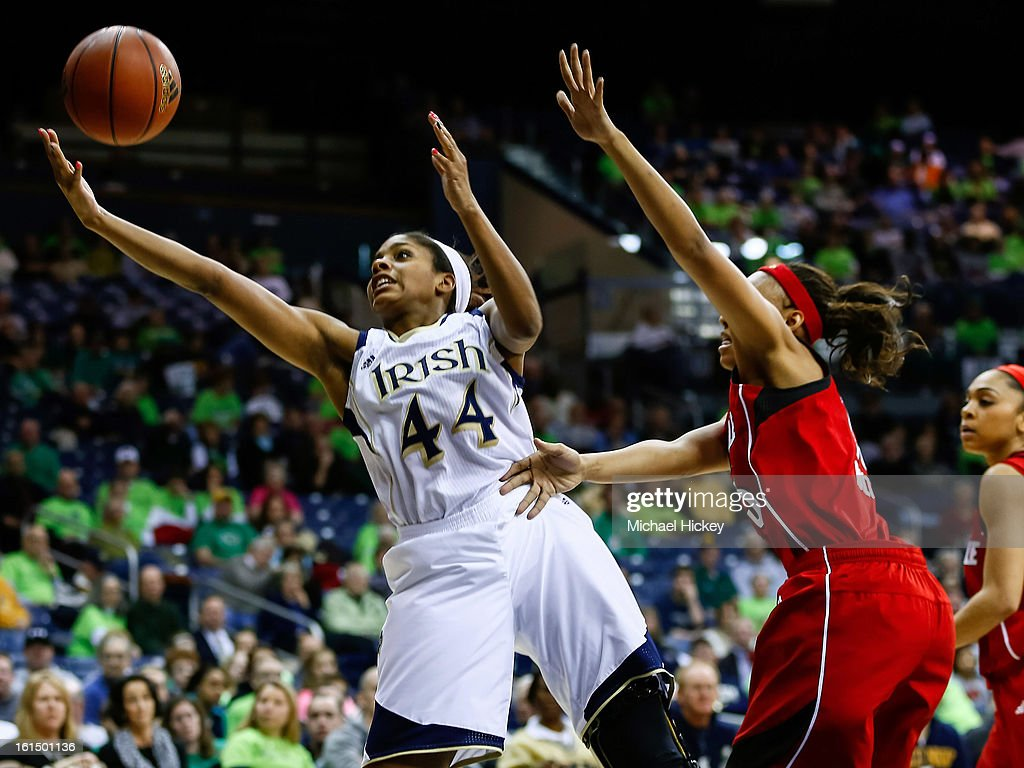 Ariel Braker #44 of the Notre Dame Fighting Irish reaches for the ball against the Louisville Cardinals at Purcel Pavilion on February 11, 2013 in South Bend, Indiana. Notre Dame defeated Louisville 93-64.