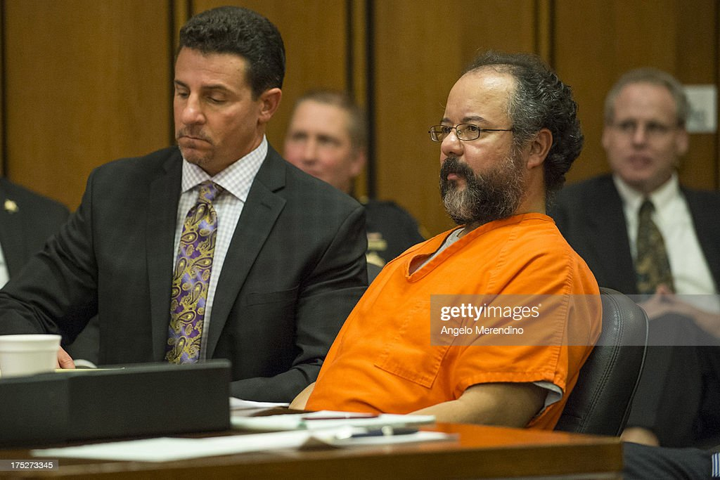 Ariel Castro pleads to Judge Michael Russo during his sentencing on August 1, 2013 in Cleveland, Ohio. Castro se,ntenced to life without parole plus one thousand years for abducting three women between 2002 and 2004 when they were between 14 and 21 years old. Castro told Judge Michael Russo, 'I'm not a monster, I'm sick...I'm a happy person inside.'