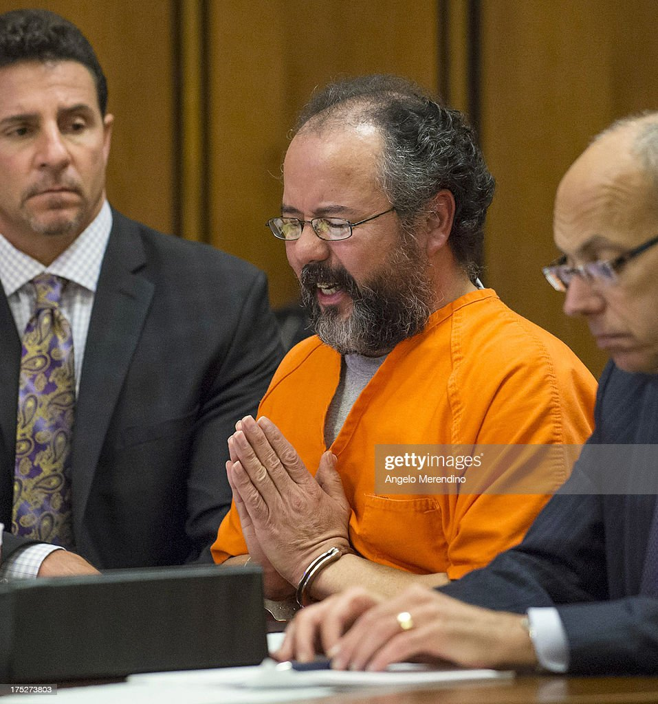 <a gi-track='captionPersonalityLinkClicked' href=/galleries/search?phrase=Ariel+Castro&family=editorial&specificpeople=10896456 ng-click='$event.stopPropagation()'>Ariel Castro</a> pleads to Judge Michael Russo during his sentencing on August 1, 2013 in Cleveland, Ohio. Castro sentenced to life without parole plus one thousand years for abducting three women between 2002 and 2004 when they were between 14 and 21 years old. Castro told Judge Michael Russo, 'I'm not a monster, I'm sick...I'm a happy person inside.'