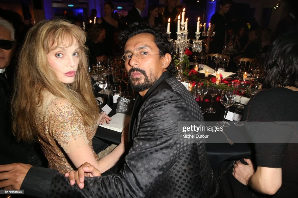 Ariel Dombasle and Haider Ackermann attend the Babeth Djian Hosts Dinner For Rwanda To The Benefit Of A.E.M. on December 6, 2012 in Paris, France.