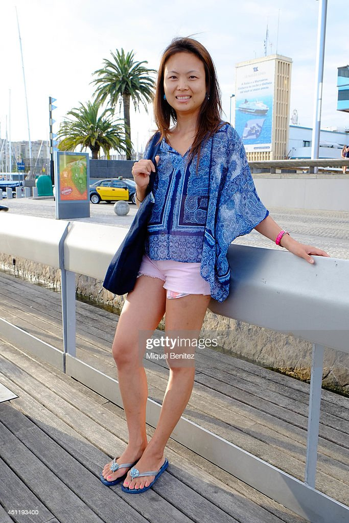 Ariel from Malaysia seen wearing a Mango's shirt, a Mango's shorts from Doha, Hawaiian's sandals from Sau Paulo and a Nanan's handbag from Bali on June 25, 2014 in Barcelona, Spain.