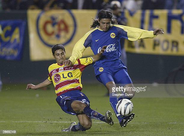 Ariel Gonzalez of Club America controls the ball from Mariano Trujillo of Monarcas Morelia in the second place finishers match of the Interliga...