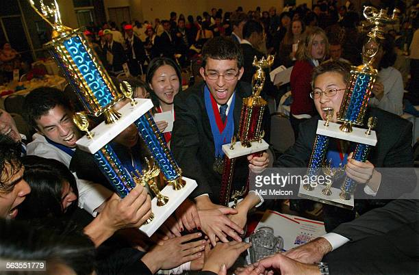 Ariel Hecht senior center and Shin–Yong Kang junior far right celebrate with other members of their academic decathlon team from Beverly Hills HS...