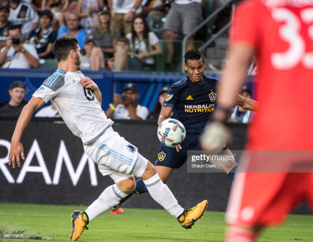Ariel Lassiter #15 of Los Angeles Galaxy crosses the ball during the Los Angeles Galaxy's MLS match against Minnesota United at the StubHub Center on October 15, 2017 in Carson, California. Los Angeles Galaxy won the match 3-0