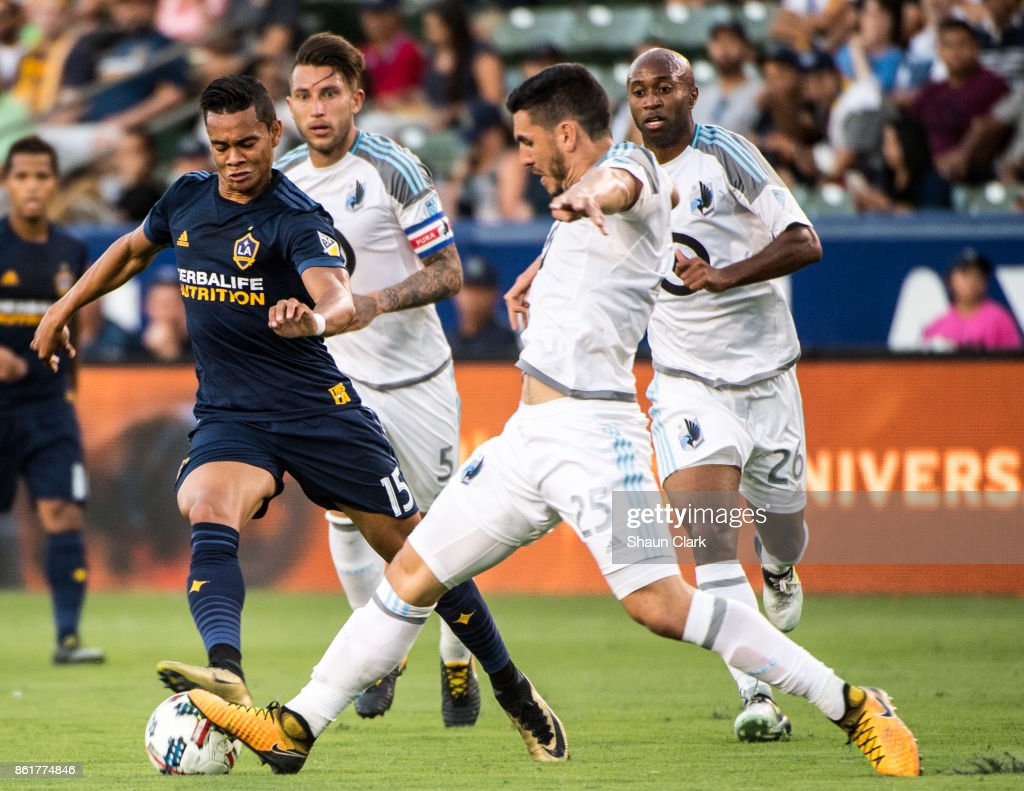 Ariel Lassiter #15 of Los Angeles Galaxy loses the ball to Michael Boxall #25 of Minnesota Unitedduring the Los Angeles Galaxy's MLS match against Minnesota United at the StubHub Center on October 15, 2017 in Carson, California. Los Angeles Galaxy won the match 3-0