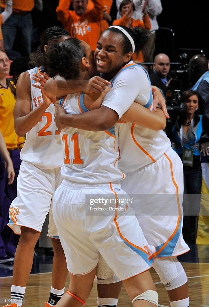 Ariel Massengale and Cierra Burdick #11 of the Tennessee Volunteers celebrate after defeating the LSU Tigers the SEC Women's Basketball Tournament Championship game at the Bridgestone Arena on March 4, 2012 in Nashville, Tennessee.