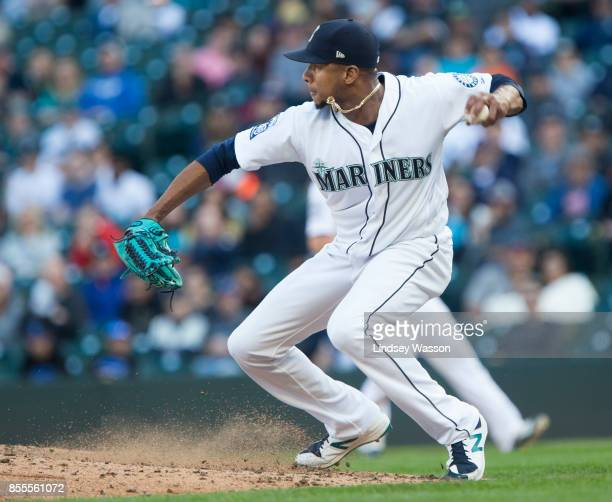 Ariel Miranda of the Seattle Mariners makes a throw to Robinson Cano of that accidentally hits Jean Segura in the hand during the game against the...